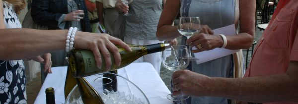 Pouring Wine at Wine Tasting