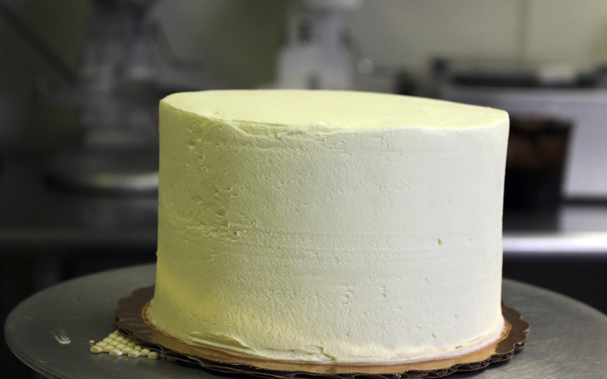 Cake with White Icing Waiting to be Decorated