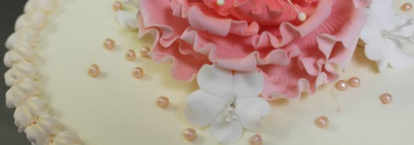 White Cake with Pink Sugar Flower