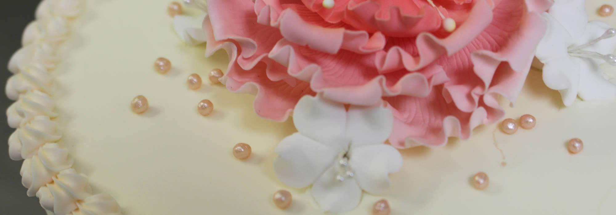 White Cake with Pink Sugar Flower