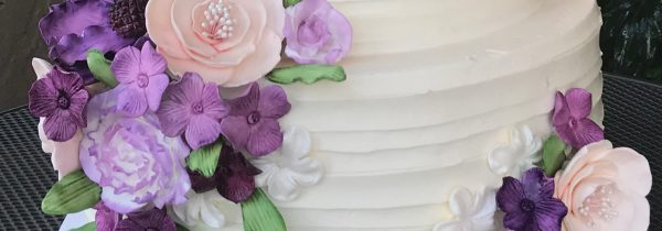 Close-Up of White Cake with Purple Flowers