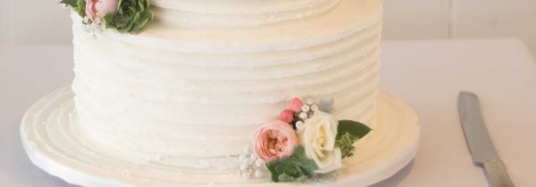 White Wedding Cake with Flowers on Base